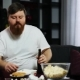 Funny Fat Guy Eating Fast Food, Drink Beer and Doing Dumbbell Training. He Is Sitting at Home on the - VideoHive Item for Sale