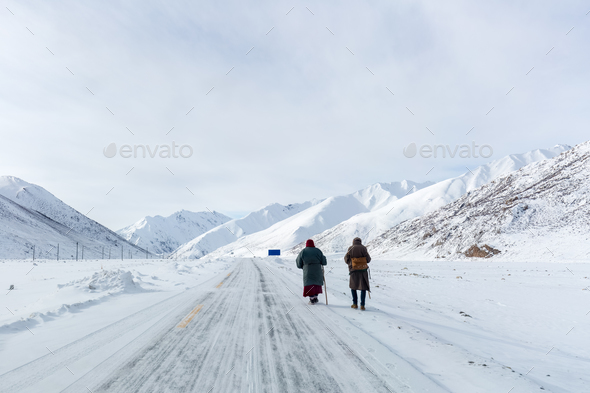 two pilgrims on snow area plateau - Stock Photo - Images