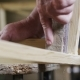 Elderly Man Carpenter Builds a Small Boat with His Hands Out of Wood in a Small Workshop - VideoHive Item for Sale