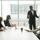 Black coach giving presentation to clients at conference meeting room - PhotoDune Item for Sale
