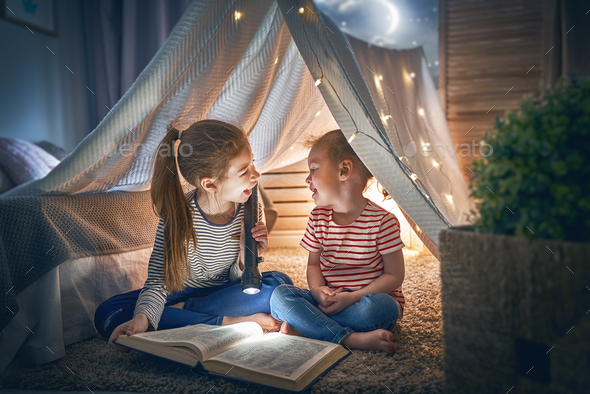 children are reading a book - Stock Photo - Images