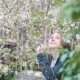 Girl in the Bushes of Cherry Blossoms - VideoHive Item for Sale