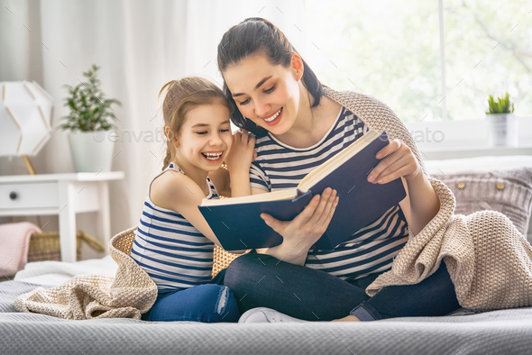 Mom and child reading a book - Stock Photo - Images