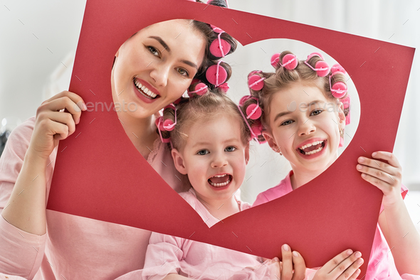 Mom and children doing hair - Stock Photo - Images