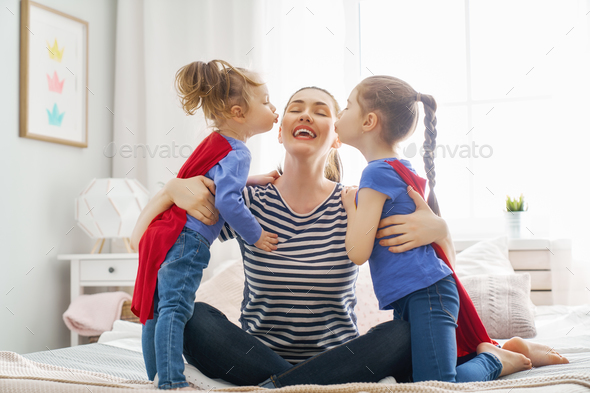 mother and daughters playing - Stock Photo - Images