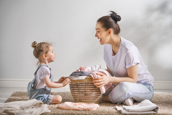family doing laundry at home - Stock Photo - Images