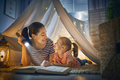 Mom and child reading a book - PhotoDune Item for Sale