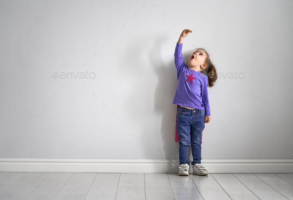child is playing superhero - Stock Photo - Images