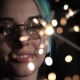 Hipster Girl with Blue Dyed Hair with Sparklers in Hands and Reflection of It in Glasses - VideoHive Item for Sale
