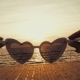Girl Puts on Vintage Heart-shaped Sunglasses on the Camera and Looks at the Sea. First-person View - VideoHive Item for Sale