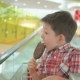 Cute Little Boy in Shopping Cart with Tasty Ice Cream during Family Shopping in Hypermarket - VideoHive Item for Sale