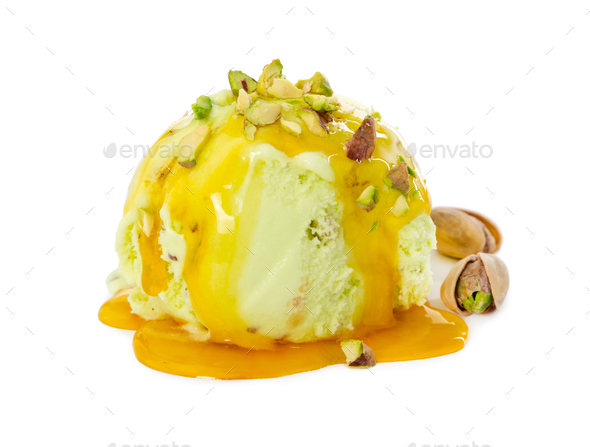 Ball pistachio ice cream with pistachios and caramel syrup isola - Stock Photo - Images
