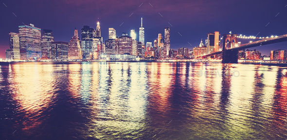 Manhattan skyline reflected in East River at night, NYC. - Stock Photo - Images