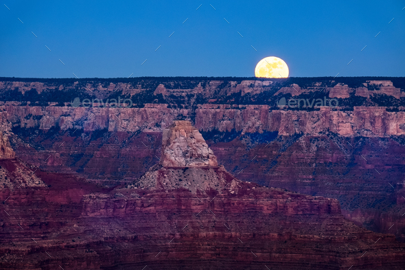 Landscape view of Grand canyon with rising moon, Arizona - Stock Photo - Images