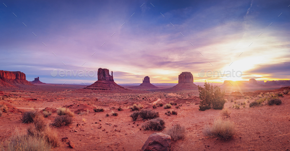 Panoramic landscape view of Monument valley at sunrise, Utah - Stock Photo - Images