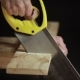 Man Sawing Wooden Board with Hand Saw - VideoHive Item for Sale