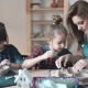 Mother And Two Daughters In A Creative Class In The Pottery Workshop - VideoHive Item for Sale
