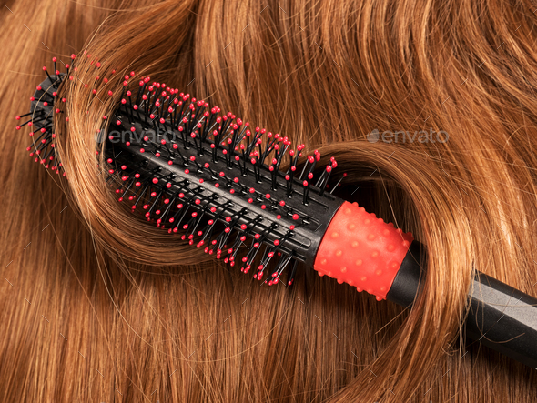 Long red human hair with a comb - Stock Photo - Images