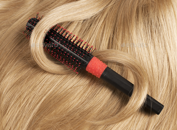 Long blond human hair with a comb - Stock Photo - Images