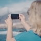 Woman with a Smartphone Makes Photos on the Beach - VideoHive Item for Sale