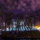 view of Winter City Park at Night with Leafless Trees and People - VideoHive Item for Sale