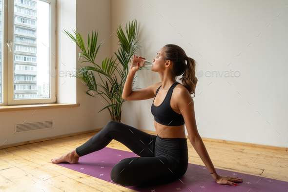 athletic female drinking water - Stock Photo - Images