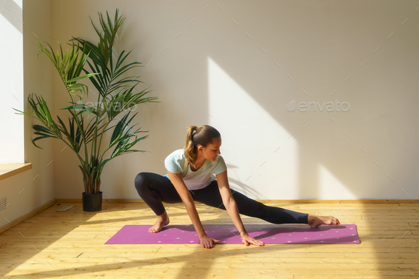 young fit woman doing stretching exercise - Stock Photo - Images