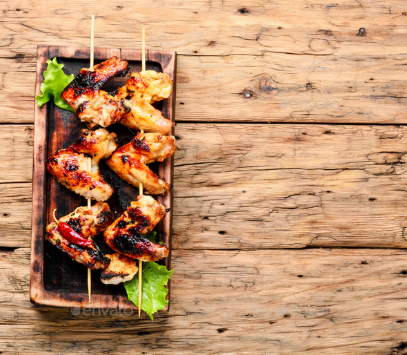 Tasty grilled chicken wings - Stock Photo - Images