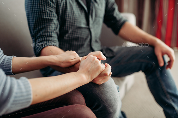 Couple hold hands, family psychology support - Stock Photo - Images
