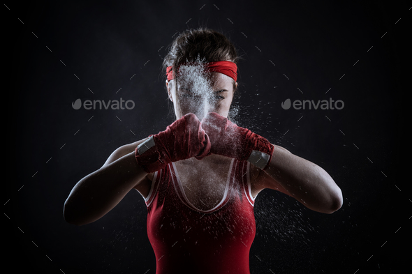 Female athlete in boxing bandages and sportswear - Stock Photo - Images