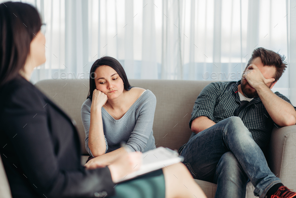 Stressed couple patients at psychologist reception - Stock Photo - Images