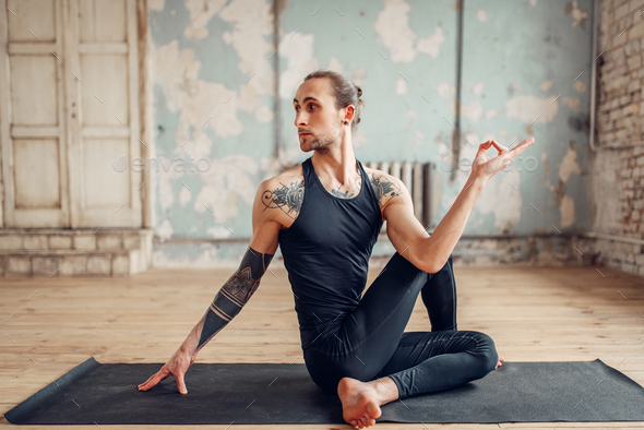 Male yoga doing flexibility exercise - Stock Photo - Images