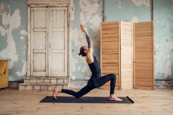 Male yoga with tattoo on hand doing exercise - Stock Photo - Images
