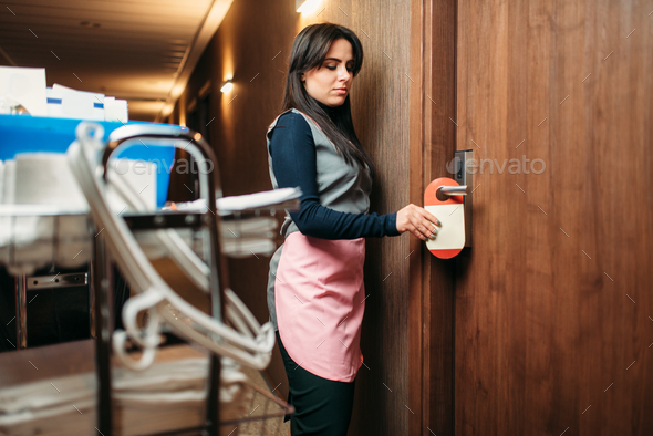Housemaid in uniform finished cleaning the room - Stock Photo - Images