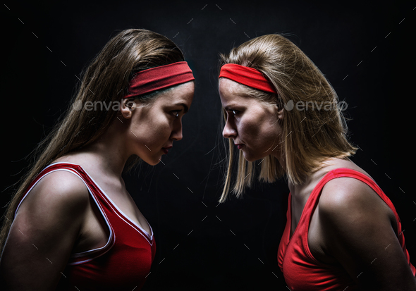 Two female boxers standing face to face - Stock Photo - Images