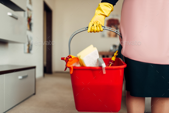 Housemaid hands in gloves holds cleaning equipment - Stock Photo - Images