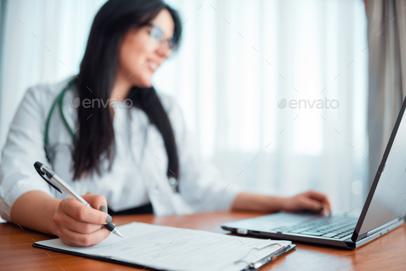 Family doctor concept, specialist works on laptop - Stock Photo - Images