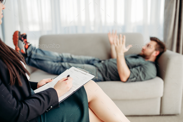 Male patient at psychologist reception, stress - Stock Photo - Images