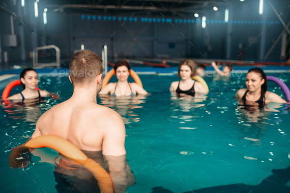 Trainer and group, workout in swimming pool - Stock Photo - Images