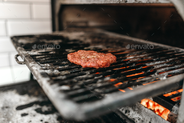 meat on grill oven, burger cooking - Stock Photo - Images