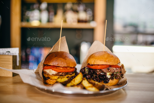 Fresh grilled burgers and on the table - Stock Photo - Images