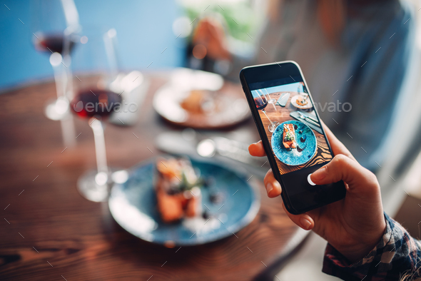Female person makes shot of red wine and dessert - Stock Photo - Images