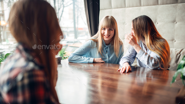 Happy girlfriends drinks coffee in cafe - Stock Photo - Images