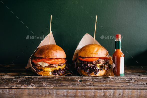 Fresh grilled burgers and ketchup on the table - Stock Photo - Images