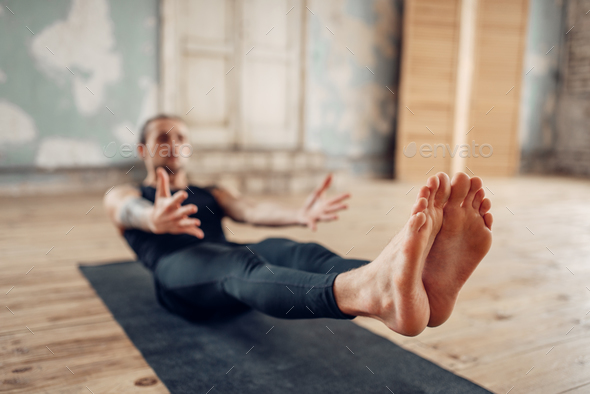 Male yoga in class, press training - Stock Photo - Images