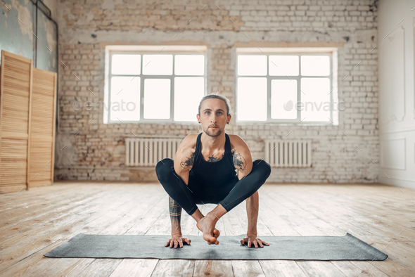 Male yoga in class, balance training - Stock Photo - Images