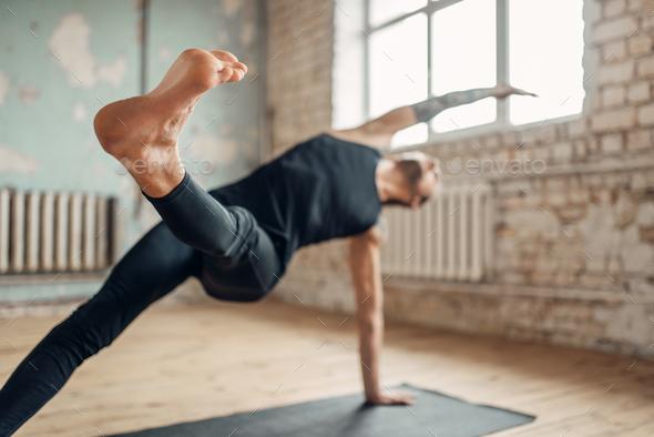 Yoga training in studio with grunge interior - Stock Photo - Images