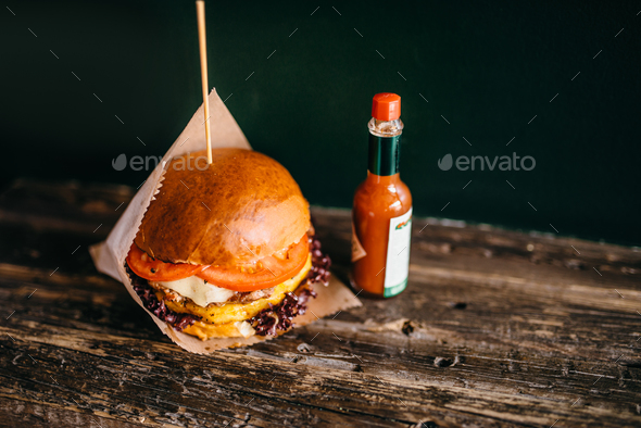 Grilled burger and potato on the table, closeup - Stock Photo - Images