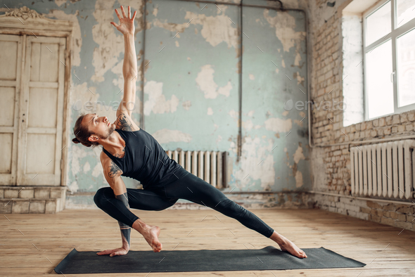 Yoga training in studio with grunge interior - Stock Photo - Images