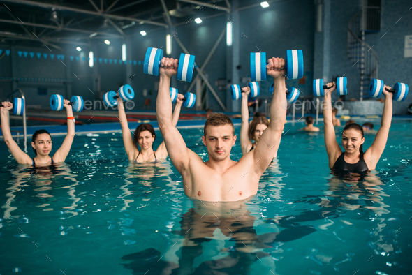 Aqua aerobics group, exercise with dumbbells - Stock Photo - Images